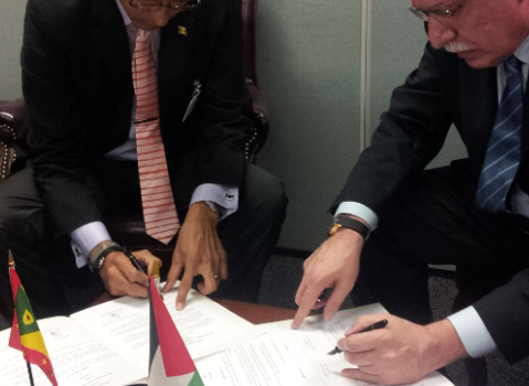 Foreign Minister Malki, Right, signs the Joint Communique with his counterpart, Foreign Minister Steele of Grenada