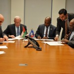 Foreign Minister Malki, center left, signs the Joint Communique with his counterpart Foreign Minister Casimir of Haiti